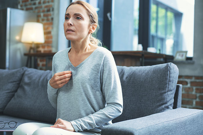 Woman is experiencing hot flushes due to menopause